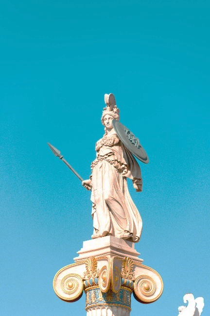A statue of a person holding a sword Description automatically generated with medium confidence