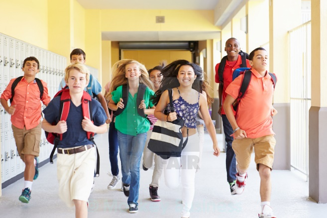 Group Of High School Students Running Along Corridor - License, download or print for £12.00 | Photos | Picfair